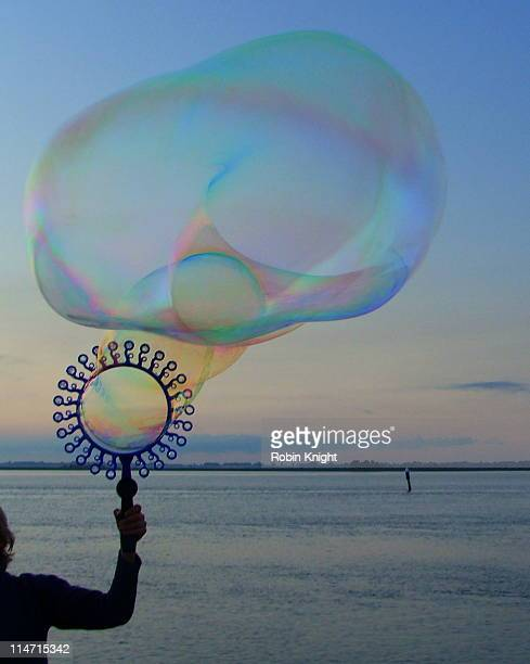 Large soap bubble being blown