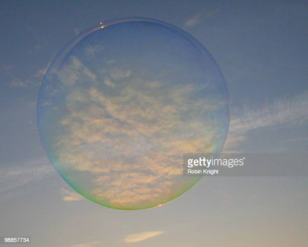 Large soap bubble in a wispy sky