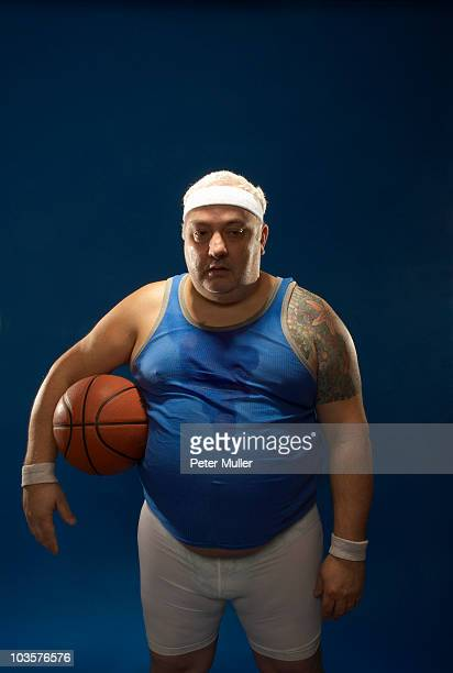 large sportsman holding basketball - sportsperson stock pictures, royalty-free photos & images