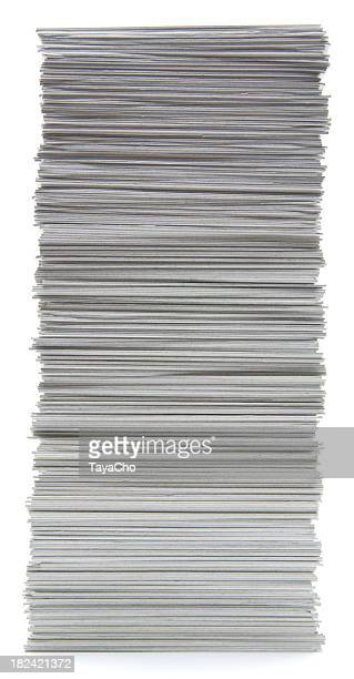 Large stack of hand trimmed cards on a white background