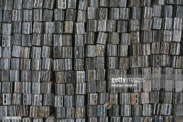 large stack of wooden pallets photographed by drone, england, united kingdom - pallet industrial equipment stock pictures, royalty-free photos & images