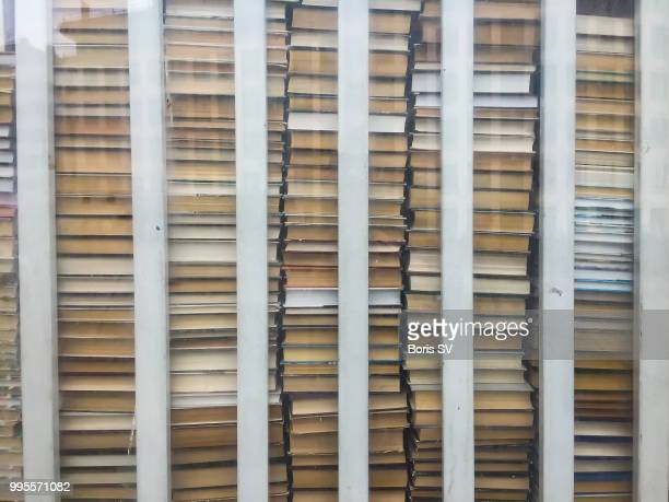 Large stacks of books behind the bars