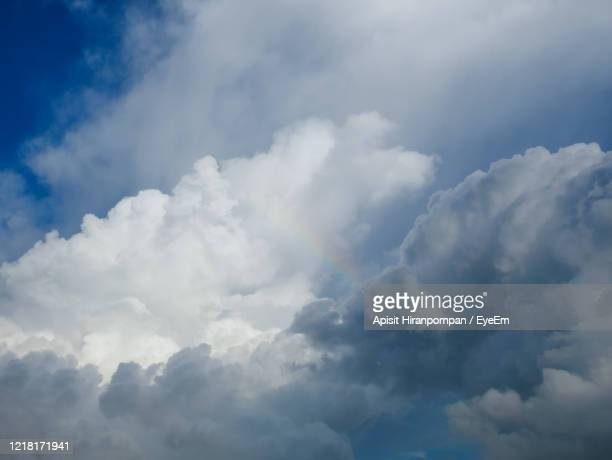 large storm cloud and blue sky in rainy season with rainbow after the rain. - apisit hiranpornpan stock pictures, royalty-free photos & images