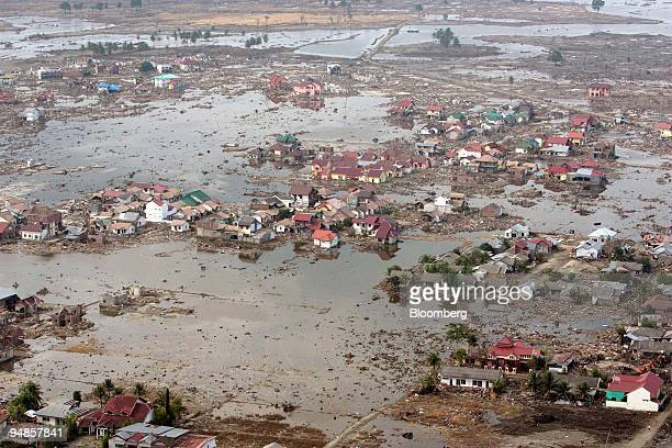 Large swathes of the provincial capital of Indonesia Banda Aceh lies in ruin on Monday January 3 2005 US navy helicopters stationed on the USS...