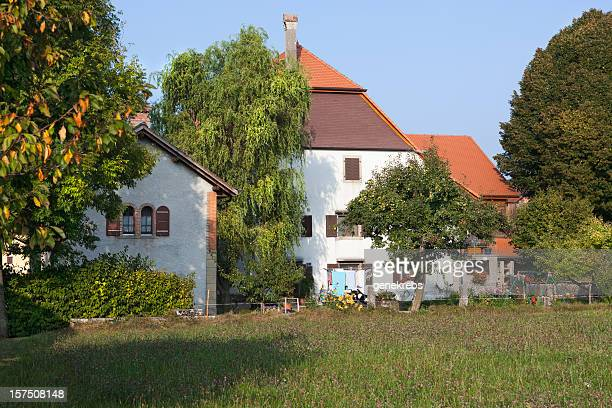 large swiss romand farm with field, trees, outbuildings - vaud canton stock pictures, royalty-free photos & images