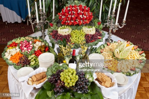 Large Table Display Of Mixed Fruits Vegetables Crackers