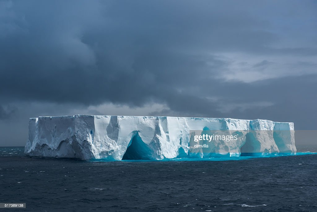 Large tabular iceberg floating in Antarctica : Stock Photo