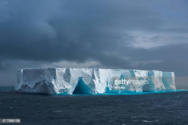 large tabular iceberg floating in antarctica - berg stock pictures, royalty-free photos & images