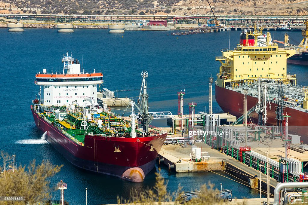 large tankers unloading crude oil : Stock Photo