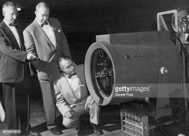 A large television projector used to relay TV programs from Denver General hospital to the Lincoln room of the Shirley Savoy hotel is examined by Dr...