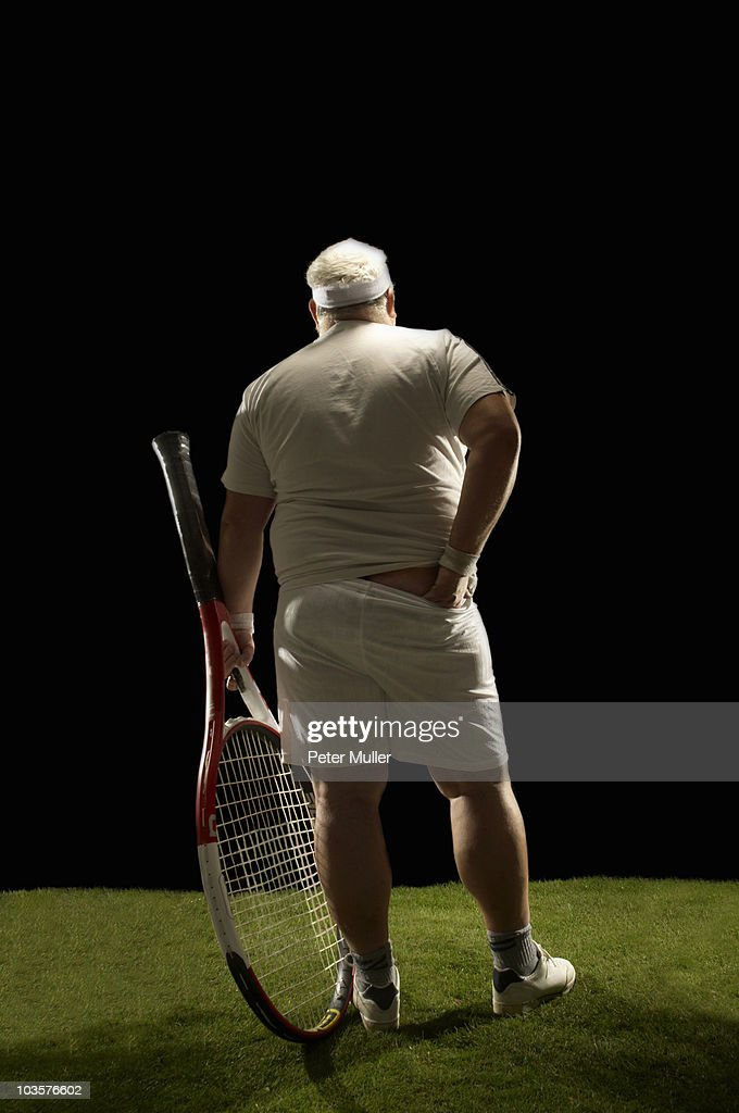 Large tennis player rear view : Stock Photo
