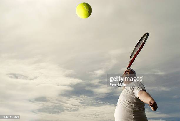 large tennis player with giant racquet - man with big balls stock photos and pictures