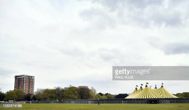 Large tent goes up in Sefton Park in Liverpool, north-west England on April 28 ahead of live music concert expected to host 5,000 people on Sunday,...
