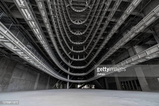 large three-dimensional space inside modern concrete building, 3d rendering - undone stock pictures, royalty-free photos & images