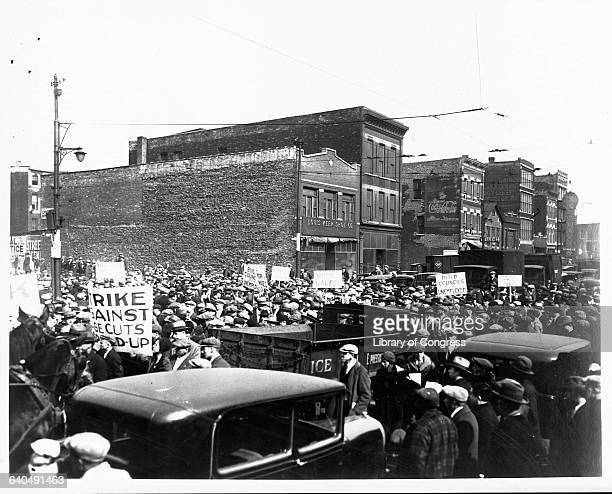 A large throng of Communist demonstrators parades down Roosevelt Road in Chicago They are part of the International Unemployment Day labor protest...