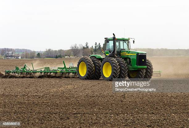 large tractor in spring - john deere stock pictures, royalty-free photos & images