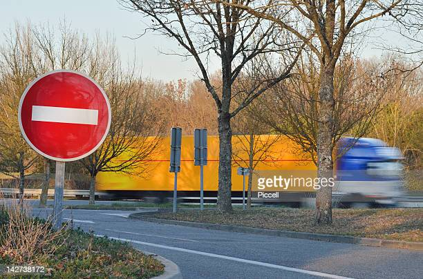 Large truck passing a no-entry sign on motorway