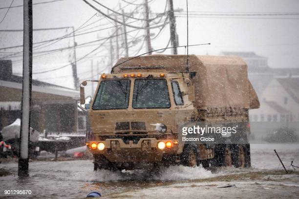 A large truck patrols the flooded Brant Rock area of Marshfield Mass were flooded by the astronomically high tides during a winter storm on Jan 4 2018
