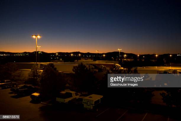 Large Trucks at Truck Stop Next to Parking Lot at Night