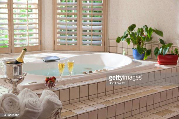 Large tub with champagne and windows