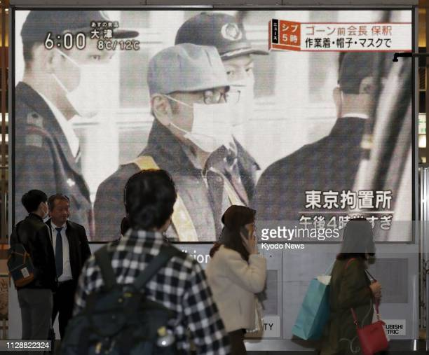A large TV screen on a street in Osaka shows news of former Nissan Motor Co Chairman Carlos Ghosn's release on bail on March 6 after 108 days in...