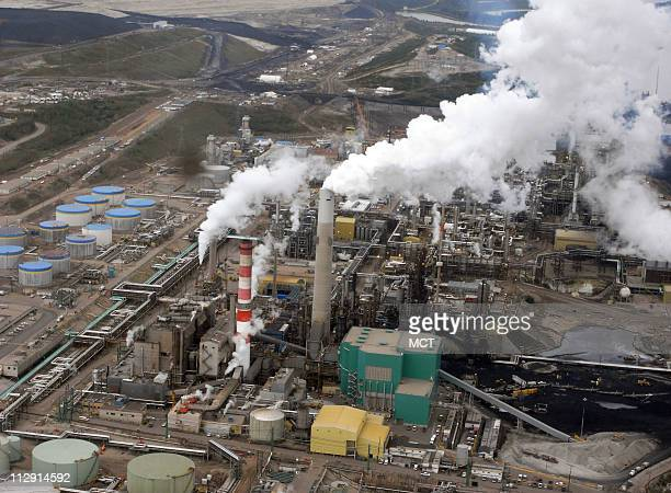 Large upgrader facilities convert the thick form of crude oil extracted from nearby oil sands mines into a synthetic crude oil that is sent by...