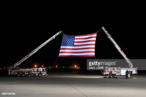 TOPSHOT A large US flag is set up ahead of the arrival of US detainees Kim Haksong Tony Kim and Kim Dongchul after they were freed by North Korea at...