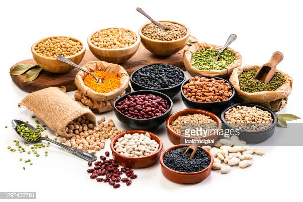 large variety of dried beans, legumes and cereals isolated on white background - saco objeto manufaturado imagens e fotografias de stock