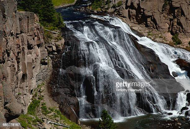 a large waterfall, gibbon falls, on gibbon river - timothy hearsum stock photos and pictures