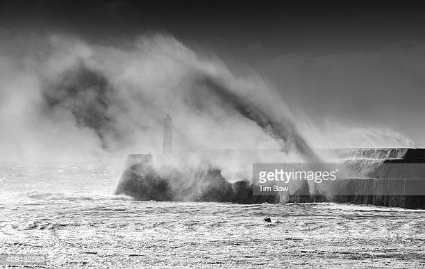 Large wave masks the pier in Porthcawl as the first big UK winter storm shows its face in late Oct 2013
