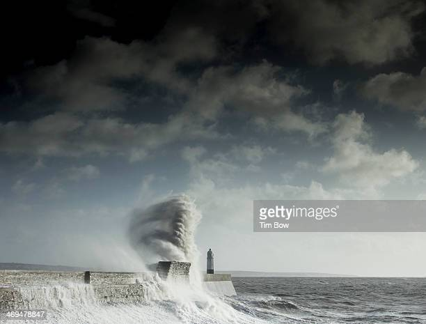 CONTENT] A large wave rises high over Porthcawl Pier in the tail end of the big Hercules winter storm to attack the UK early this year
