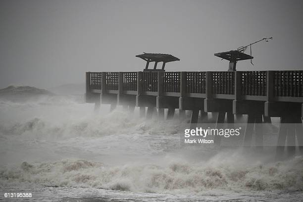 Large waves caused by Hurricane Matthew pound the Jacksonville Pier and was damaged by the storm, October 7, 2016 in Jacksonville Beach, Florida....