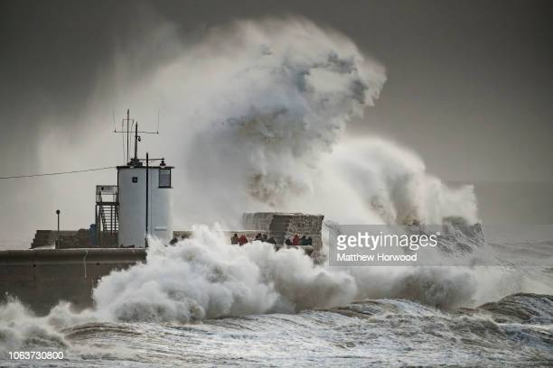Large waves crash against the harbour wall during Storm Eleanor in Porthcawl on January 3, 2018 in Cardiff, United Kingdom.