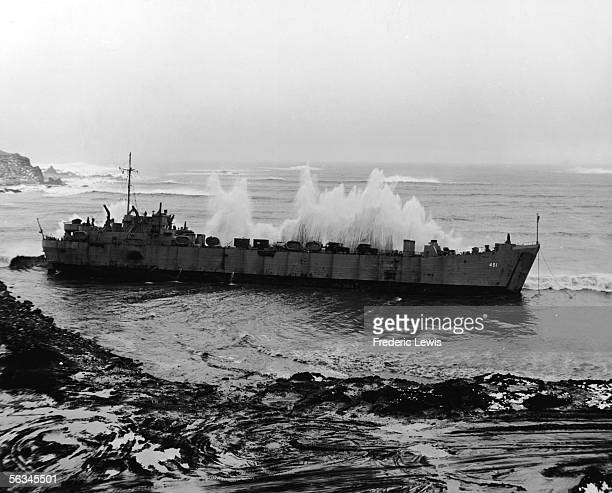 Large waves crash upon an American tank landing ship moored in an outpost in the Aleutian Islands Alaska February 29 1944 The ship had been damaged...