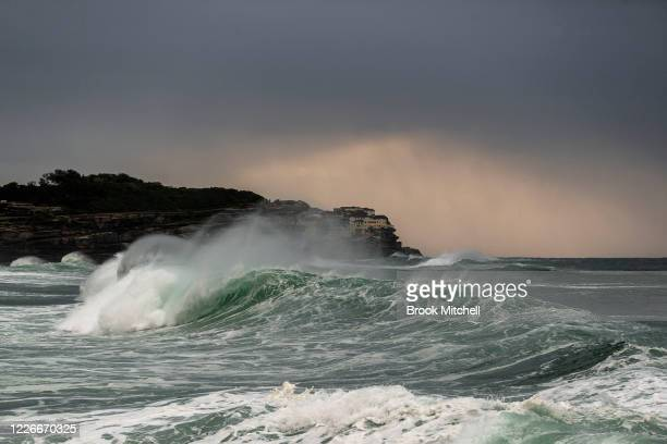 Large waves impact the coastline at Bronte Beach on May 24 2020 in Sydney Australia Winter weather including rain and strong winds is expected to...