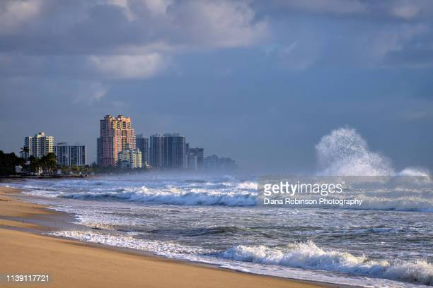 large waves pound the shore on fort lauderdale beach just after sunrise, fort lauderdale, florida - sunrise fort lauderdale stock pictures, royalty-free photos & images