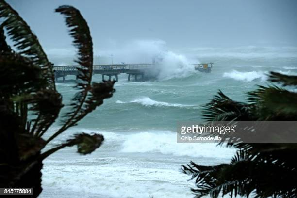 Large waves produced by Hurricane Irma crash into the end of Anglins Fishing Pier September 10 2017 in Fort Lauderdale Florida The category 4...