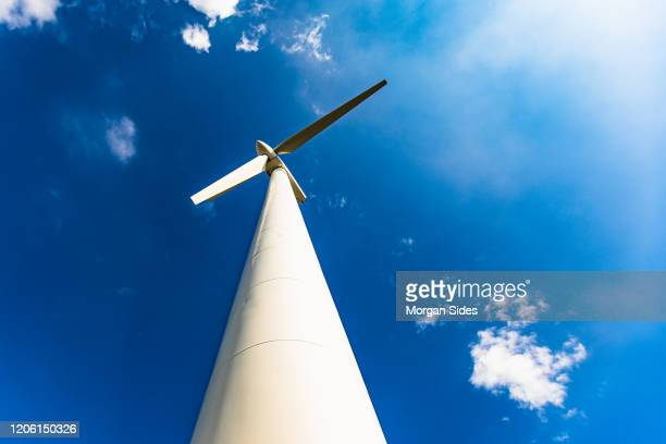 large wind turbine from below - planet earth stock pictures, royalty-free photos & images