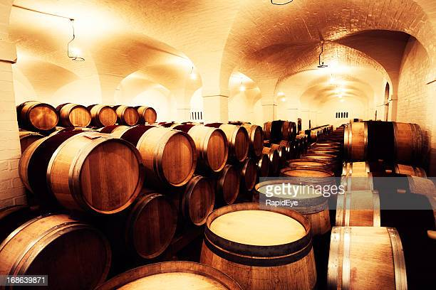 stacked oak barrels maturing red wine. Large Winery Cellar Filled With Oak Barrels Of Maturing Wine Stacked Red D
