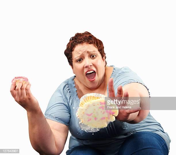 広々とした女性の糞カップケーキ