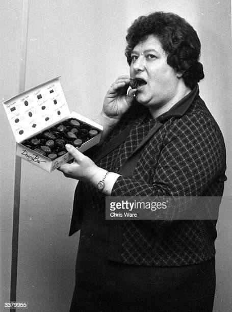 A large woman eating Dairy Box chocolates