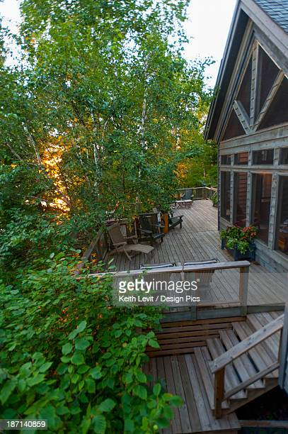 Large Wooden Deck On The Back Of A House