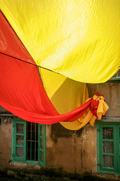 Large yellow and red flag in alley
