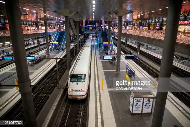 Largely empty platforms are seen as trains stand idle at Berlin's main station during a strike on December 10 2018 Long distance and local trains...