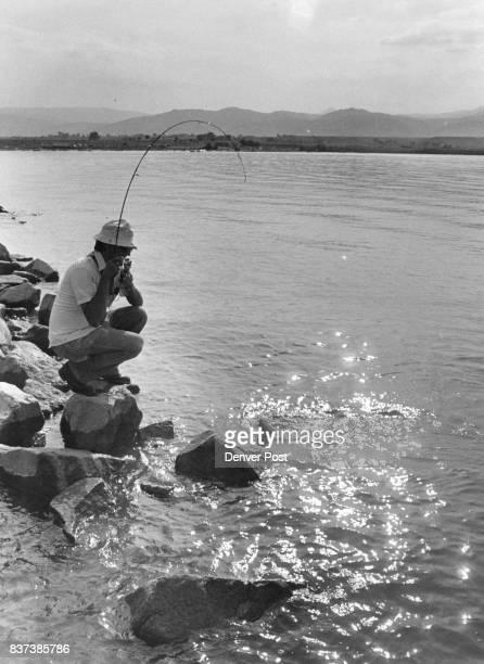 A largemouth bass signals surrender at Boulder reservoir Credit The Denver Post