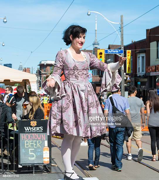 PORTUGAL TORONTO ONTARIO CANADA Larger than life statue of a woman wearing frock in a welcoming pose at the Dundas West Festival 2015 Little Portugal...