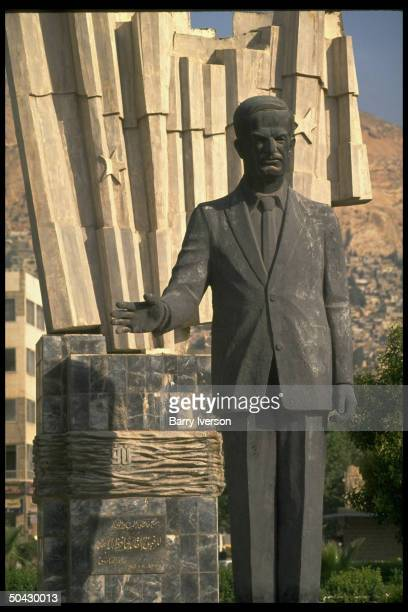 Largerthanlife statue of Pres Assad holding sway over downtown section