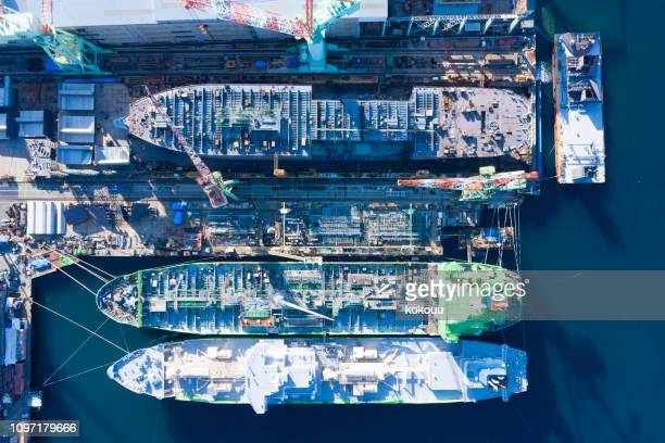 large-scale outdoor shipyard.high angle view. - shipyard stock pictures, royalty-free photos & images