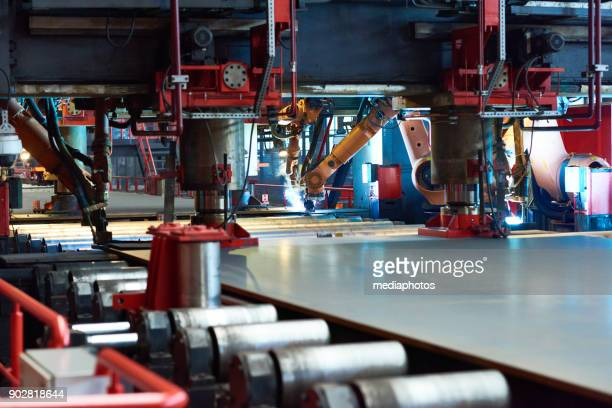 large-scale production at tube rolling plant - sheet metal stock pictures, royalty-free photos & images