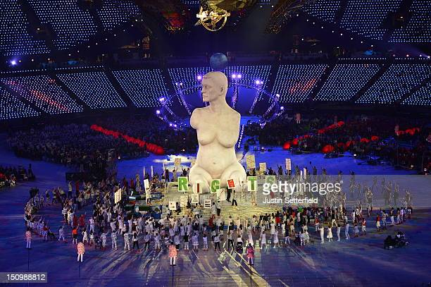 Large-scale replica of Marc Quinn's sculpture, 'Alison Lapper Pregnant', emerges from the book stage during the Opening Ceremony of the London 2012...